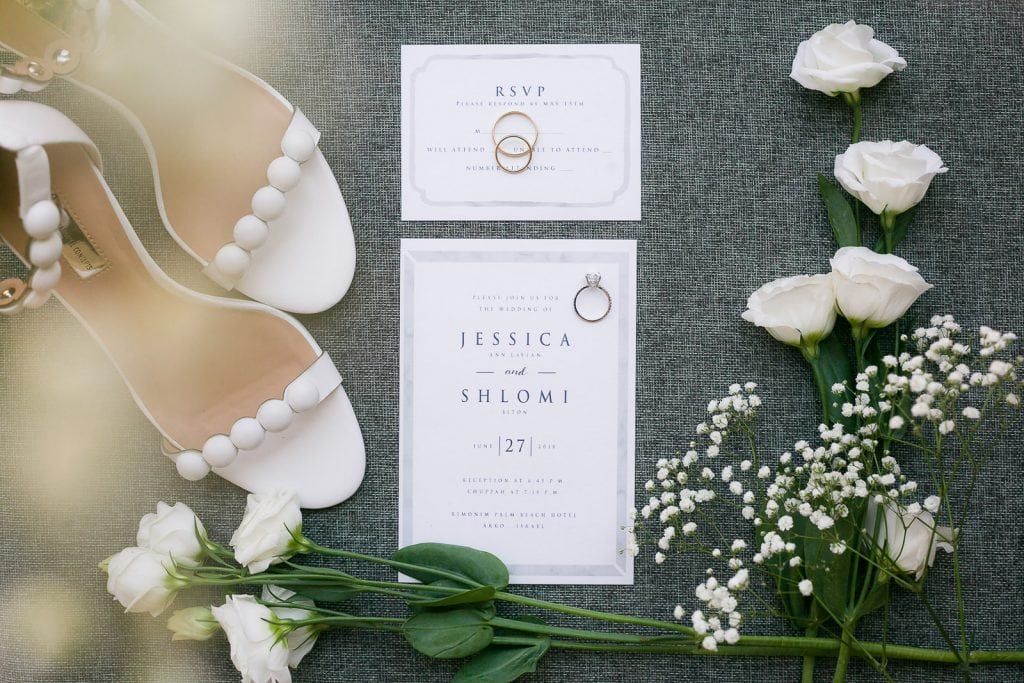 A lovely layout wedding invitation with shoes and flowers