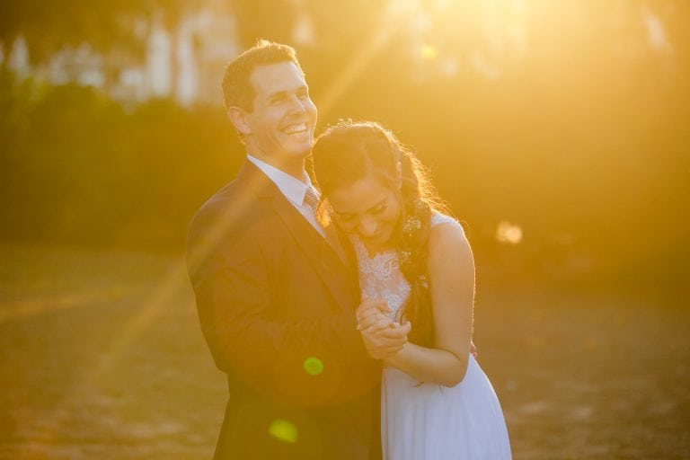 wedding day portrait laughing couple