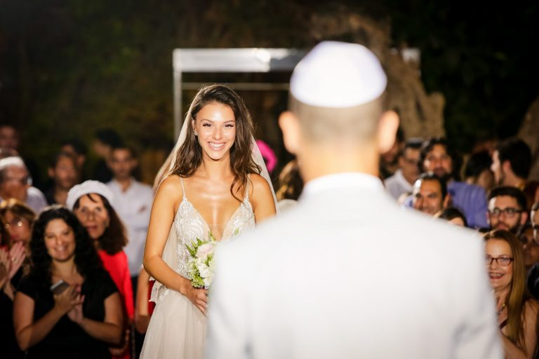 Bride looking at her groom at wedding ceremony