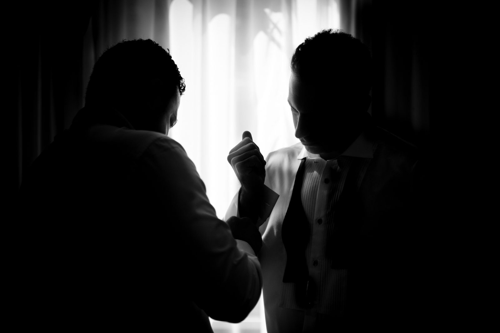 Groom and best man getting ready for wedding