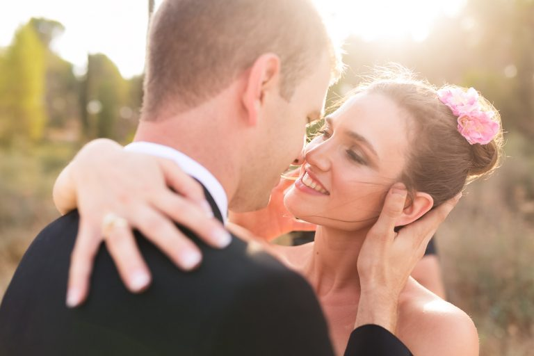 Romantic portrait of newly married couple almost kissing