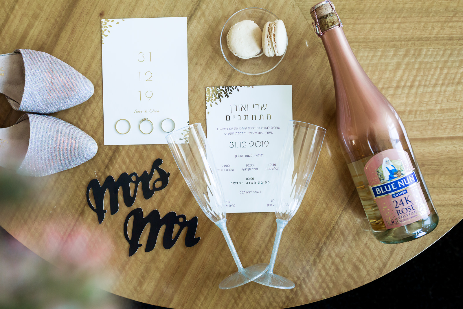 Wedding invitation layout with champagne and some accessories