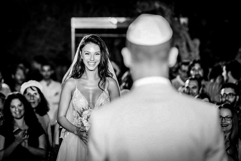 bride looking at groom at Jewish wedding ceremony
